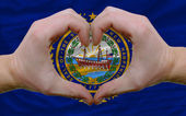 Over american state flag of new hampshire showed heart and love — Stock Photo