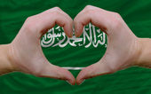Over flag of saudi arabia showed heart and love gesture made by — Stock Photo