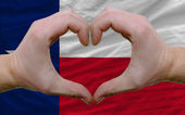 Over american state flag of texas showed heart and love gesture — Stock Photo