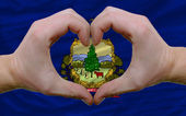 Over american state flag of vermont showed heart and love gestur — Stock Photo