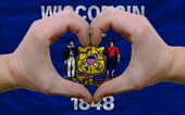 Over american state flag of wisconsin showed heart and love gest — Stock Photo