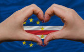 Over flag of cape verde showed heart and love gesture made by ha — Stock Photo