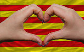 Over flag of catalonia showed heart and love gesture made by han — Stock Photo