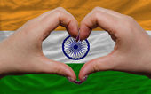 Over flag of india showed heart and love gesture made by hands — Stock Photo