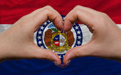 Over american state flag of missouri showed heart and love gestu — Stock Photo