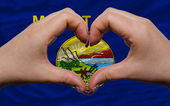 Over american state flag of montana showed heart and love gestur — Stock Photo