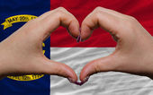 Over american state flag of north carolina showed heart and love — Stock Photo