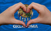 Over american state flag of oklahoma showed heart and love gestu — Stock Photo