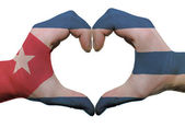Heart and love gesture in cuba flag colors by hands isolated on — Stock Photo