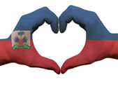 Heart and love gesture in haiti flag colors by hands isolated on — Stock Photo