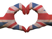 Heart and love gesture in great britain flag colors by hands iso — Stock Photo