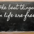 Expression -  The best things in life are free - written on a sc — Zdjęcie stockowe