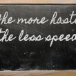 Expression -  The more haste, the less speed - written on a scho — Photo