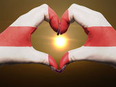 Heart and love gesture by hands colored in england flag during b — Stock Photo