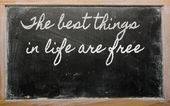 Expression - The best things in life are free - written on a sc — Foto Stock