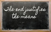 Expression - The end justifies the means - written on a school — Stok fotoğraf