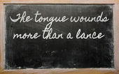 Expression - The tongue wounds more than a lance - written on a — Stock Photo