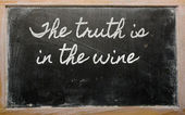 Expression - The truth is in the wine - written on a school bla — Stock Photo