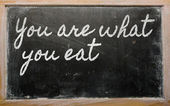 Expression - You are what you eat - written on a school blackbo — Stock Photo