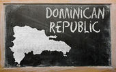 Outline map of dominican on blackboard — 图库照片