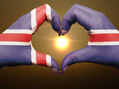 Heart and love gesture by hands colored in iceland flag during b — Stock Photo