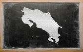 Outline map of costa rica on blackboard — Zdjęcie stockowe