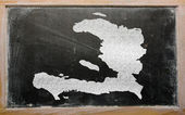 Outline map of haiti on blackboard — Stock Photo