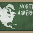 Stock Photo: Outline map of north america on blackboard
