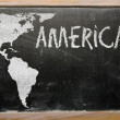Outline map of america on blackboard — Stock Photo