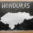 Stock Photo: Outline map of honduras on blackboard