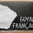 Outline map of french guiana on blackboard — Stock Photo