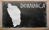Outline map of dominica on blackboard — Stockfoto