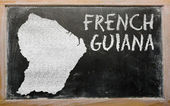Outline map of french guiana on blackboard — Stok fotoğraf