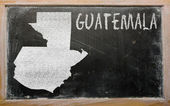 Outline map of guatemala on blackboard — Stock Photo
