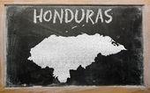 Outline map of honduras on blackboard — Stock Photo