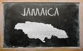 Outline map of jamaica on blackboard — Stock Photo