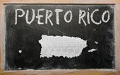 Outline map of puerto rico on blackboard — Stock Photo