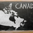 Outline map of canada on blackboard — Stock Photo