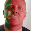 Face of serious patriot man painted in colors of portugal flag — Stock Photo #9192872