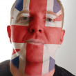 Face of serious patriot man painted in colors of united kingdom — Stock Photo