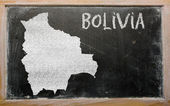 Outline map of bolivia on blackboard — Stock Photo