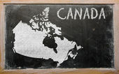 Outline map of canada on blackboard — Zdjęcie stockowe
