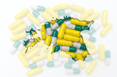 Outline map of estonia with pills in the background for health a — Stock Photo