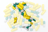 Outline map of italy with pills in the background for health and — Stock Photo