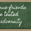 Expression - True friends are tested in adversity - written on — Stock Photo
