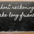 Expression -  Short reckonings make long friends - written on a — Zdjęcie stockowe