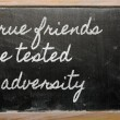 Stock Photo: Expression - True friends are tested in adversity - written on