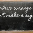 Expression -  Two wrongs don't make a right - written on a schoo — Stock Photo