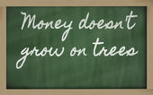 Expression - Money doesn't grow on trees - written on a school — Zdjęcie stockowe