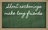 Expression - Short reckonings make long friends - written on a — Stock Photo